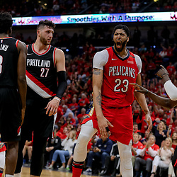 Apr 21, 2018; New Orleans, LA, USA; New Orleans Pelicans forward Anthony Davis (23) reacts after dunking against Portland Trail Blazers center Jusuf Nurkic (27) and forward Al-Farouq Aminu (8) during the fourth quarter in game four of the first round of the 2018 NBA Playoffs at the Smoothie King Center.  Pelicans defeated the Trail Blazers 131-123 sweeping the series and advancing to the western conference semi-finals.  Mandatory Credit: Derick E. Hingle-USA TODAY Sports