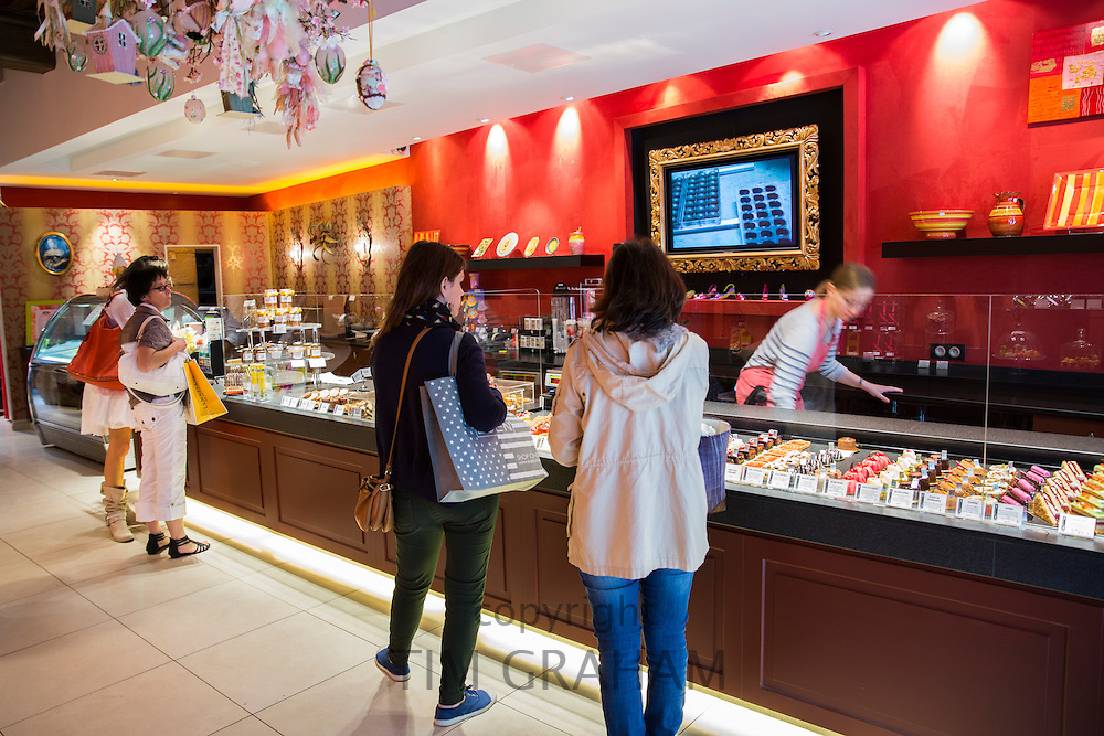 Shoppers in Patisserie and Chocolatier shop Carbillet in Rue des Forges in Dijon in the Burgundy region of France