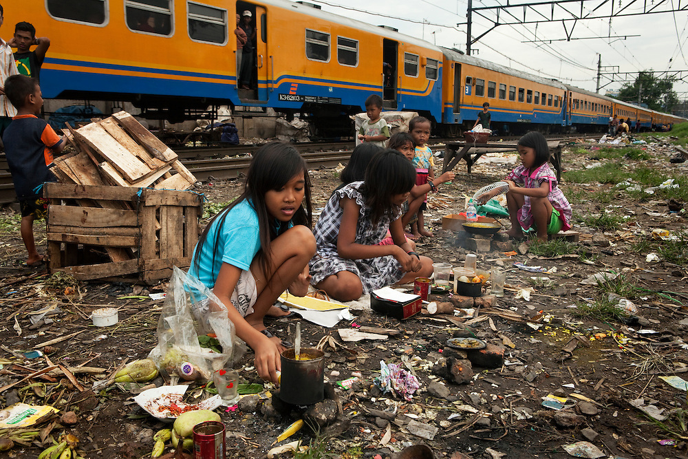 There is not much outdoor space in the crowded area Tambor, so the children play next to he railway tracks. Jakarta, Indonesia.