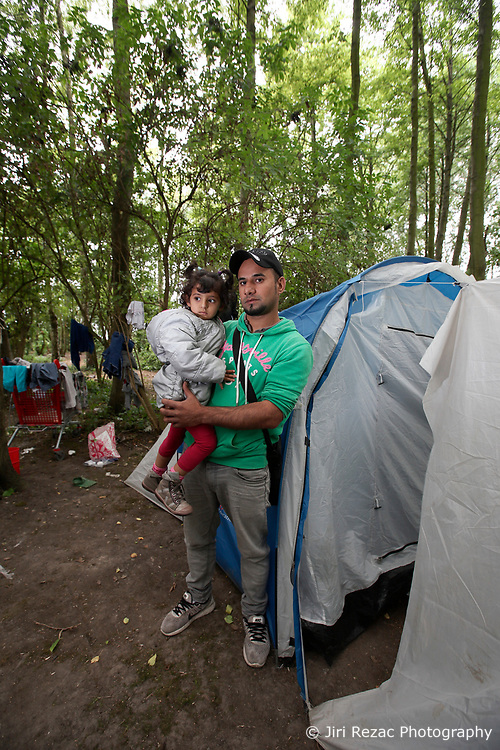 FRANCE GRANDE SYNTHE 2AUG17 - Iraqi Kurd Marding Sokolom, 30, and his daughter Aya, 3 stand on front of  their damaged tent in the unofficial Jungle II camp near Grande Synthe, Dunkirk, northern France.<br /> <br /> He claims to have relatives living in the UK and has been at the camp for nearly one month. They have travelled for 6 months to get here, including a 6-day boat ride across the Mediterranean with 100 fellow refugees - a journey during which all thought they would drown. <br /> <br /> jre/Photo by Jiri Rezac<br /> <br /> &copy; Jiri Rezac 2017