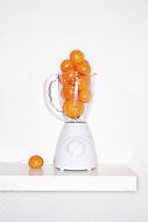 Orange fruits in blender