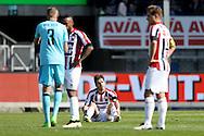 01-05-2016 VOETBAL:WILLEM II - FEYENOORDTILBURG<br /> Dries Wuytens van Willem II (grond) teleurgesteld na afloop van de wedstrijd en Jordens Peters van Willem II (R) en Funso Ojo van Willem II (L) <br /> <br /> <br /> Foto: Geert van Erven