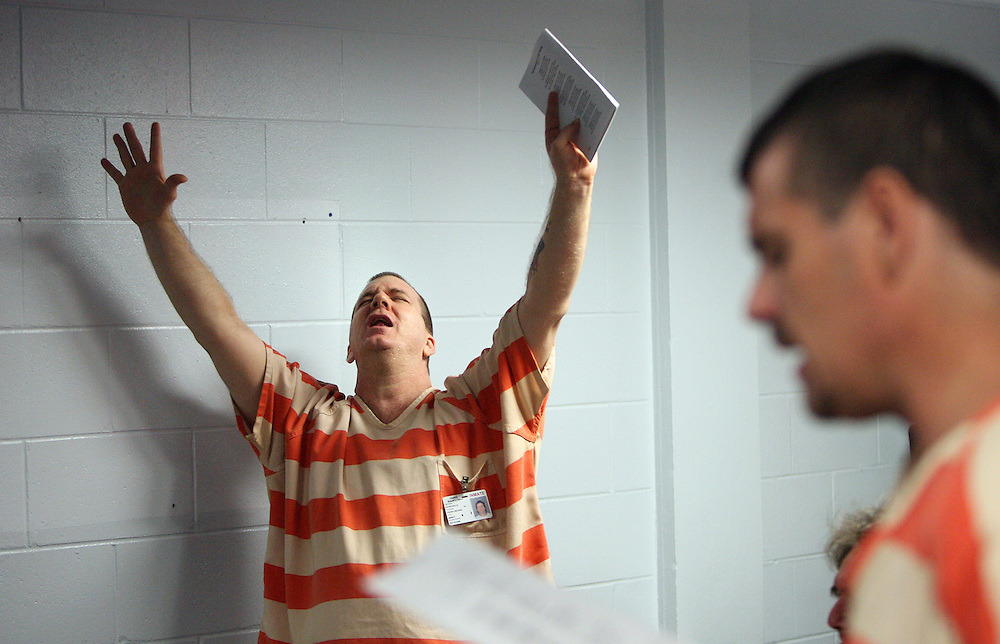 BRENDAN FITTERER | Times (Land O'Lakes, FL 3/19/2012).TP_351563_FITT_recover_1.Pasco Jail inmate Joseph Churchville raises his arms in worship as he and other inmates sing during a gathering of the jail's Celebrate Recovery program Monday. It is a faith-based addiction recovery program..BRENDAN FITTERER | Times