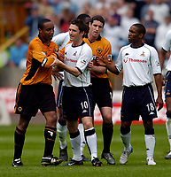 Photo. Jed Wee, Digitalsport<br /> NORWAY ONLY<br /> <br /> Wolverhampton Wanderers v Tottenham Hotspurs, FA Barclaycard Premiership, 15/05/2004.<br /> Wolves' Paul Ince (L) signs out from the Premiership amidst more controversy as he is sent off for a second yellow card for bringing down Spurs' Jamie Redknapp, and has to be restrained by Spurs' Robbie Keane.