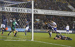 Millwall's DJ Cambell scores his sides first goal 1-1 as Millwall's Andrew Keogh lies injured - Photo mandatory by-line: Robin White/JMP - Tel: Mobile: 07966 386802 28/01/2014 - SPORT - FOOTBALL - The Den - Millwall - Millwall v Sheffield Wednesday - Sky Bet Championship