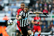 Islam Slimani (#13) of Newcastle United battles for possession of the ball with Mathias Zanka Jorgensen (#25) of Huddersfield Town during the Premier League match between Newcastle United and Huddersfield Town at St. James's Park, Newcastle, England on 31 March 2018. Picture by Craig Doyle.