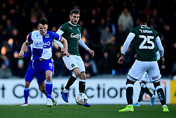 Ollie Clarke of Bristol Rovers is challenged by Danny Mayor of Plymouth Argyle - Mandatory by-line: Ryan Hiscott/JMP - 01/12/2019 - FOOTBALL - Memorial Stadium - Bristol, England - Bristol Rovers v Plymouth Argyle - Emirates FA Cup second round