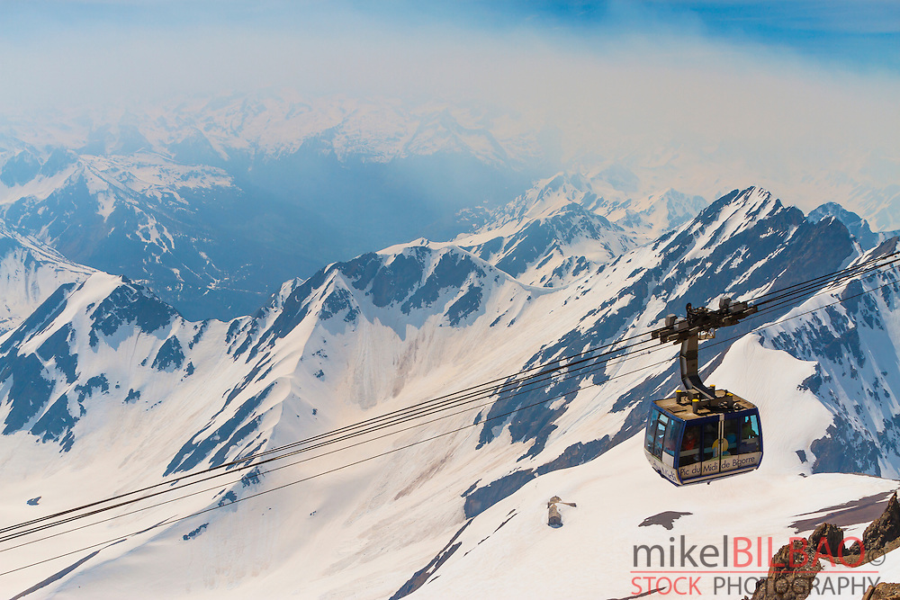 Aerial tramway and snow-covered mountains. Pic du Midi de Bigorre.<br /> Hautes-Pyrenees department, Midi-Pyrenees region, France, Europe.