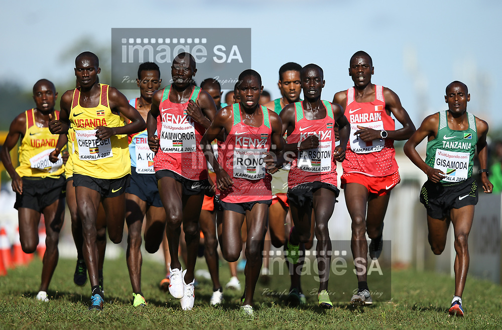 KAMPALA, UGANDA - MARCH 26: Joshua Cheptegei of Uganda, Stanley Kebenei (USA), Vincent Kipping Rono of Kenya and Albert Rop of Bahrain leads the pack during the senior mens race of the 2017 Kampala IAAF World Cross Country Championships on March 26, 2017 in Kampala, Uganda. (Photo by Roger Sedres/ImageSA)