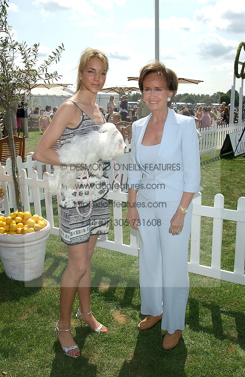 Left to right, LADY ISABELLA HERVEY and her mother YVONNE, MARCHIONESS OF BRISTOL at the 2004 Cartier International polo day at Guards Polo Club, Windsor Great Park, Berkshire on 25th July 2004.