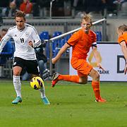 NLD/Amsterdam/20121114 - Vriendschappelijk duel Nederland - Duitsland, Marco Gotze in duel met Dirk Kuyt