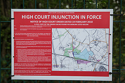 Harefield, UK. 27th April 2019. A notice on the perimeter fence of an area of land in Colne Valley which is being cleared of trees for the HS2 project. The Colne Valley is an area of natural beauty and large numbers of trees have been felled in recent weeks.