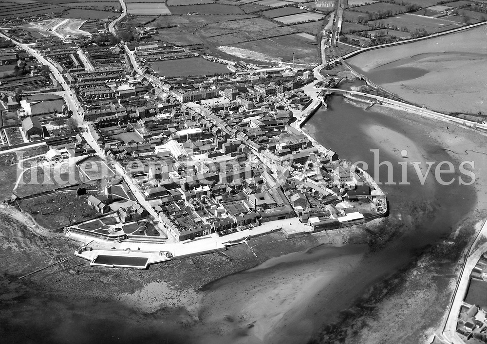 A180 Dungarvan.   15/06/51. (Part of the Independent Newspapers Ireland/NLI collection.)<br /> <br /> <br /> These aerial views of Ireland from the Morgan Collection were taken during the mid-1950's, comprising medium and low altitude black-and-white birds-eye views of places and events, many of which were commissioned by clients. From 1951 to 1958 a different aerial picture was published each Friday in the Irish Independent in a series called, 'Views from the Air'.