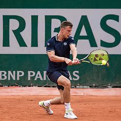May 29, 2018 - Paris, France - Márton Fucsovics of Hungary returns the ball to Vasek Pospisil of Canada during the first round at Roland Garros Grand Slam Tournament - Day 3 on May 29, 2018 in Paris, France. (Credit Image: © Robert Szaniszlo/NurPhoto via ZUMA Press)