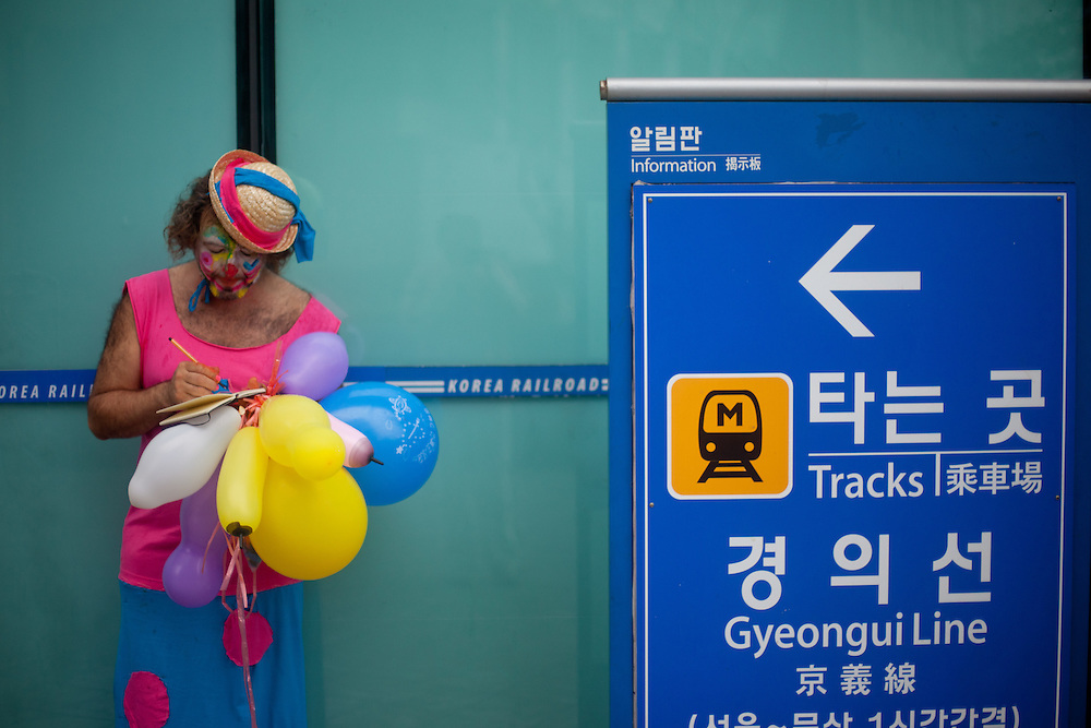 "Clown at ""Seoul Station"" on a Sunday morning in the South Korean capital."