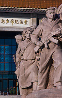 Revolutionary statues stand on both sides of Mao Zidong's memorial hall in Tiananmen Square, Beijing.