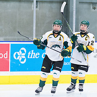 5th year forward Kylie Gavelin (13) and 5th year defender Alexis Larson (22) of the Regina Cougars  during the Women's Hockey home game on October 8 at Co-operators arena. Credit: Arthur Ward/Arthur Images