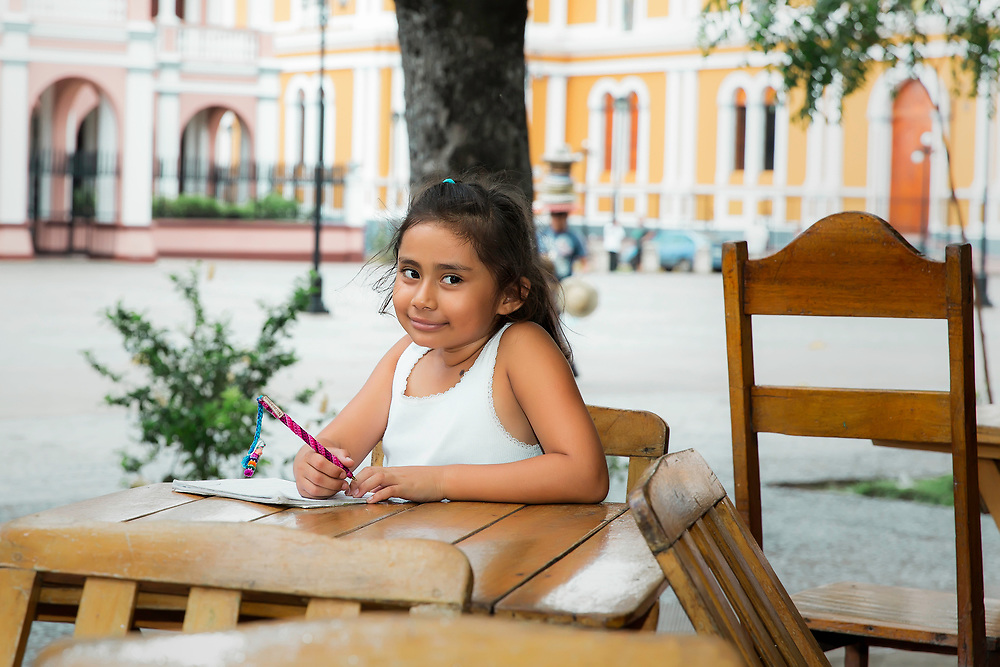 Local girl poses in Central Plaza, in Granada, Nicaragua. Copyright 2017 Reid McNally.