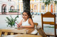 Local girl poses in Central Plaza, in Granada, Nicaragua. Copyright 2017 Reid McNally.