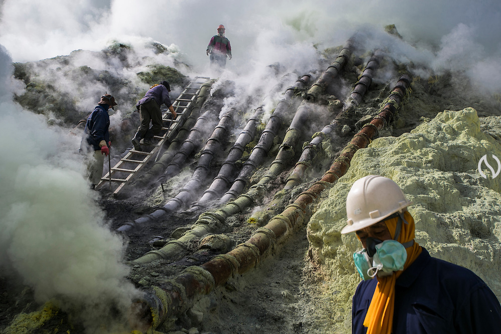 BONDOWOSO, EAST JAVA - DECEMBER 17: A miner brings an offering of goat's head upward on sulfur kitchen during annual sacrificial ritual at Ijen creater in Bondowoso, East Java, Indonesia, December 17, 2013. The miners held the sacrifice in order to ask blessing of good result and prevent from accident or injury. The tradition begun in 1978 after a tragedy that killed four people and fourteen black out cause of poisoning gas. Daily miners produce fifteen ton of sulfur or approximately 450 ton a month. Come close to 150 miners work everyday. All the sulfur goes to sugar factory ans used as sugar whitening.