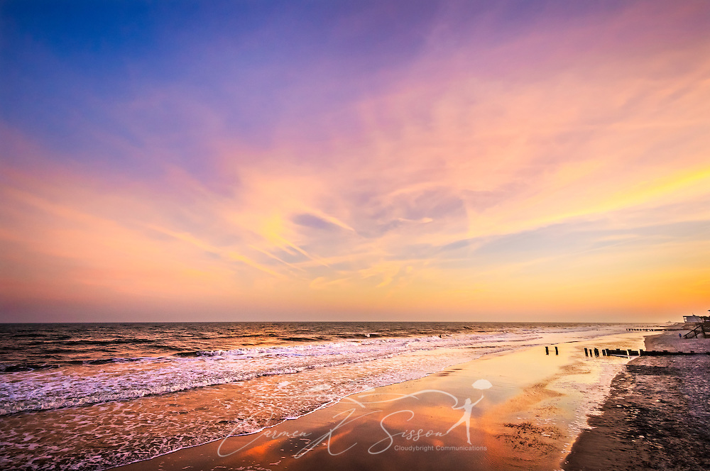 "The sun sets at the Washout on Folly Beach, April 3, 2015, in Folly Beach, South Carolina. The beach, known for its prime surfing spots like the Washout, is known as ""the Edge of America"" by locals. (Photo by Carmen K. Sisson/Cloudybright)"
