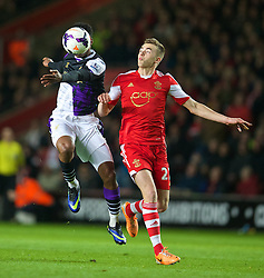 SOUTHAMPTON, ENGLAND - Saturday, March 1, 2014: Liverpool's Daniel Sturridge in action against Southampton's Calum Chambers during the Premiership match at St Mary's Stadium. (Pic by David Rawcliffe/Propaganda)
