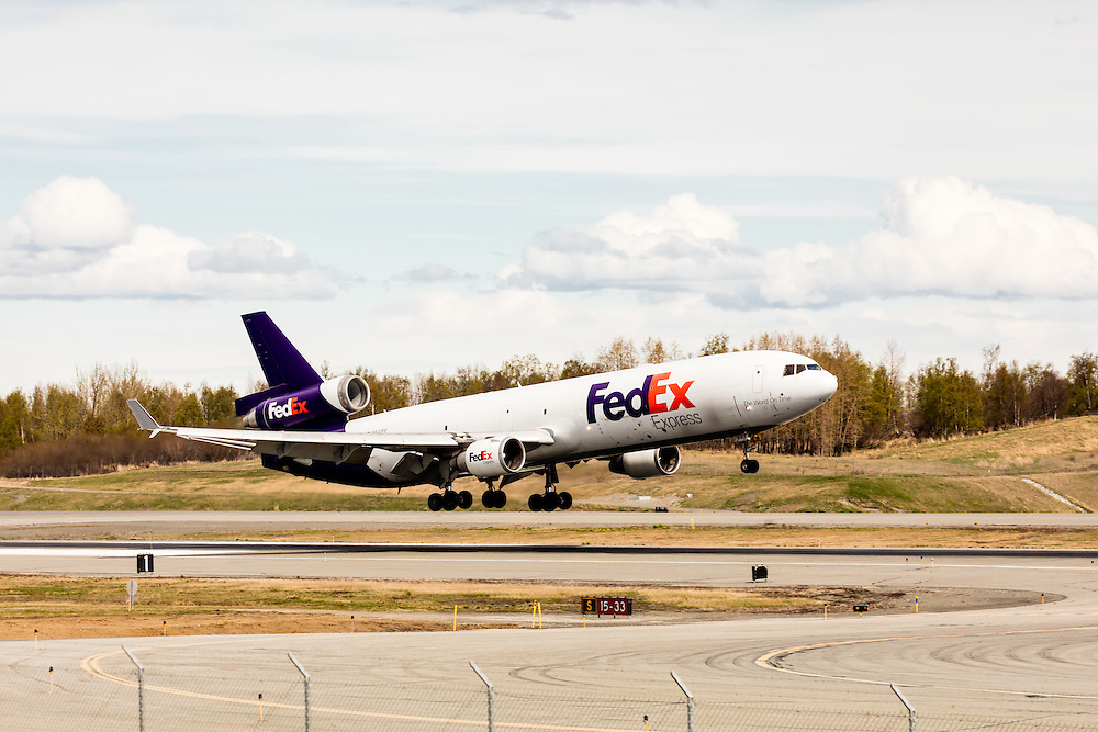 FedEx cargo jet landing at Ted Stevens Anchorage International Airport in Southcentral Alaska. Spring. Afternoon.