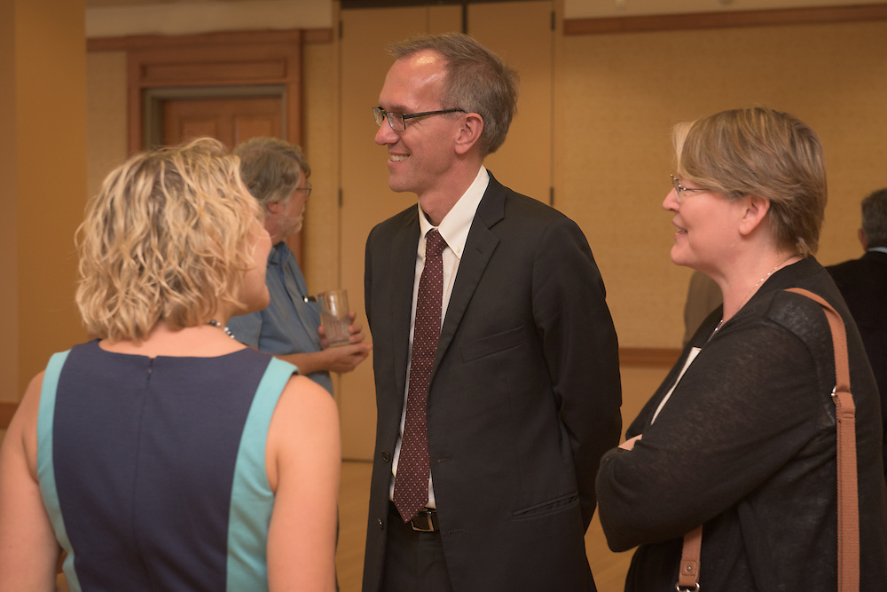 Joseph Shields, center, Vice President for Research & Creative Activity and Dean of the Ohio University Graduate College, speaks with Michele Fiala, left, one of five Presidential Research Scholar winners of the 2016 Faculty Awards and Recognition Ceremony at Ohio University's Baker University Center on Tuesday, September 6, 2016.