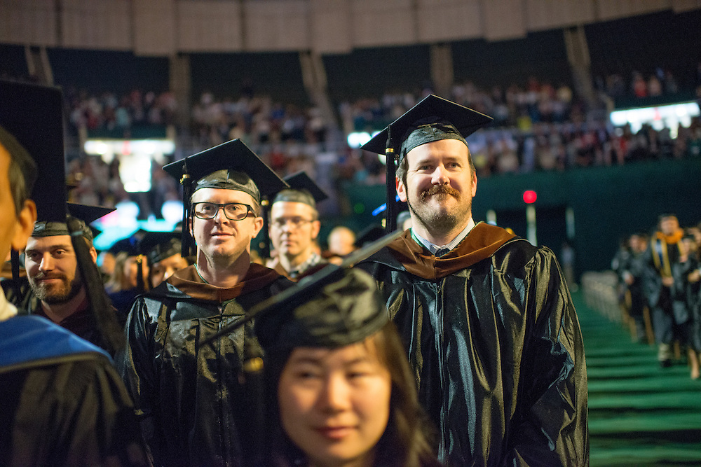 MFA graduate student Tyler Whidden (Right) at graduate commencement. Photo by Ben Siegel