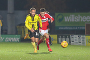 Marcus Myers-Harness of Burton Albion (16) and Dan Ward of Middlesbrough (35) during the EFL Trophy group stage match between Burton Albion and U21 Middlesbrough at the Pirelli Stadium, Burton upon Trent, England on 7 November 2018.