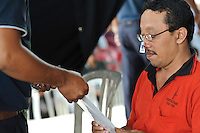 A man trying out new corrective glasses, Bali, Indonesia.