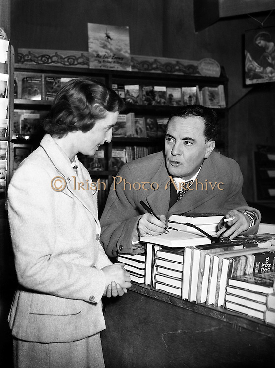 Iris Kellett with Micheal MacLiammoir in Grafton St. Bookshop.05/10/56..16 Mar 2011.DEATH OF AN IRISH LEGEND.By Louise Parkes..Iris Kellett, one of the most influential figures in the history of Irish equestrian sport, died last Friday aged 85. She leaves behind a long legacy of excellence as a competitor, trainer, breeder and horse producer but will be best remembered for her own hugely successful career and for her mentoring of many of Ireland's greatest Jumping riders including Eddie Macken...In 1935 at the age of nine, Iris walked her pony, Sparklet, from her home at Mespil Road in Ballsbridge to win her first rosette at the RDS - and she never looked back. She placed herself firmly on the map when clinching the British Ladies National Championship in 1947 and, that same year, was a member of Ireland's very first civilian Jumping side that competed in Nations Cups at Newport and Blackpool against teams from England, Sweden and Italy. Until then the sport of Nations Cup Jumping had been restricted to members of the military. She already had 150 wins at national level under her belt...She was always ahead of her time. At the age of 12 she was already teaching large numbers of pupils at her father, Harry Kellett's, riding school in Mespil Road. She carried a confidence and competence into everything in which she would become involved...Iris was just 22 years old when she won the Grand Prix at Dublin Horse Show - a feat matched by only two other Irish lady riders in the history of the event. And her career went into over-drive when, in 1949, she won the coveted Princess Elizabeth Cup at White City in London, a feat she again repeated two years later. All of these successes were recorded with her great gelding Rusty who denied his humble origins as a plough-horse to become one of the true stars of his age...A devastating schooling fall brought her career to a swift halt in 1952 however. She fell so heavily that her leg shattered and her shinbone was driven into the g