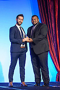 Assad Ali,college baseball assistant coach and Muhammad Ali's son, presents Navonel Glick (Voni,) of Tel Aviv, Israel, with one of the six Core Principle Awards, the Spirituality award, at the fourth annual Muhammad Ali Humanitarian Awards Saturday, Sept. 17, 2016 at the Marriott Hotel in Louisville, Ky. (Photo by Brian Bohannon for the Muhammad Ali Center)