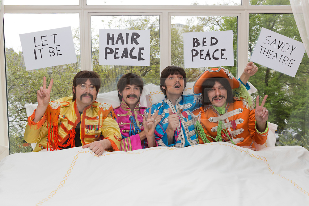 """IMAGE EMBARGOED UNTIL FRIDAY, 17 MAY 2013, 9am BST. © Licensed to London News Pictures. 16/05/2013. London, England. The cast of the Beatles show LET IT BE staged a recreation of the famous 'bed-in' scene (originally with John Lennon and Yoko Ono) in full """"Sgt Pepper"""" costumes in a room at the Savoy Hotel to coincide with the announcement of the extension of the run at the Savoy Theatre to 18 January 2014. L-R: Reuven Gershon as John Lennon, Luke Roberts as Ringo Starr, Emanuele Angeletti as Paul McCartney and Stephen Hill as George Harrison. Photo credit: Bettina Strenske/LNP"""
