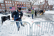 Brooklyn, NY - 2 March 2019. Volunteers clear snow from part of the quadrangle prior to Bernie Sanders' first rally for the 2020 presidential primary at Brooklyn College.