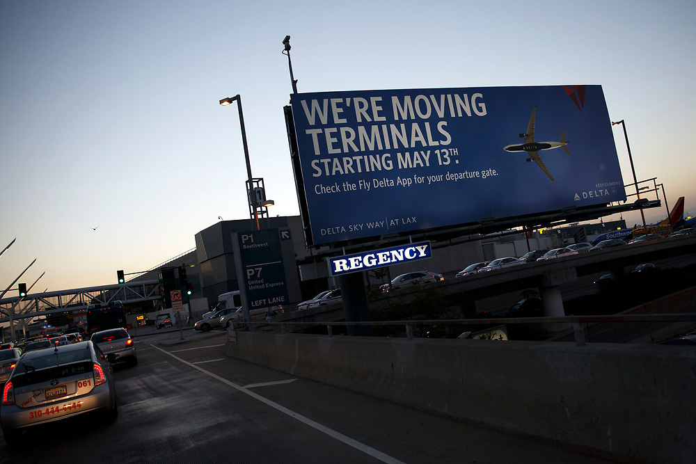 A billboard advises drivers of the Delta Airlines terminal  relocation at Los Angles International Airport (LAX) on Friday, May 12, 2017 in Los Angeles, Calif. Delta Airlines will move from Terminals 5 and 6 to Terminals 2 and 3, forcing 19 other carriers to shift their operations into the facilities vacated by Delta.  © 2017 Patrick T. Fallon