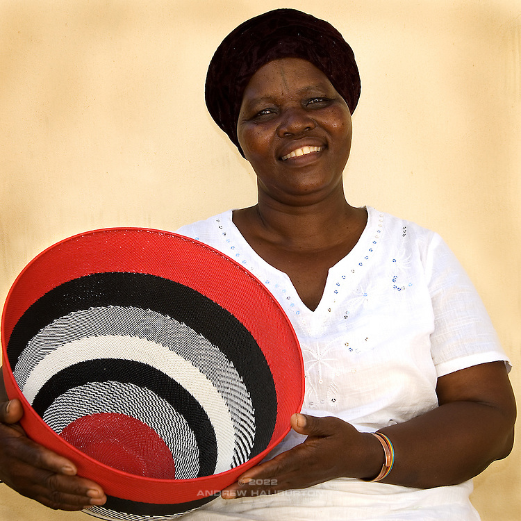 Artist Jaheni Mkhize weaves telephone wire bowls.