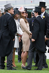© licensed to London News Pictures.16/06/2011. Ascot, UK.  Liz hurley shares a joke with a friend after watching her horse Census fail to make a place on Ladies day at Royal Ascot races today (16/06/2011). The 5 day showcase event is one of the highlights of the racing calendar. Horse racing has been held at the famous Berkshire course since 1711 and tradition is a hallmark of the meeting. Top hats and tails remain compulsory in parts of the course. Photo credit should read: Ben Cawthra/LNP