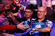 Kevin Burness high-fives the crowd before his 2nd round match with Gary Anderson during the PDC World Championship darts at Alexandra Palace, London, United Kingdom on 14 December 2018.
