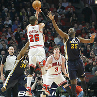 10 March 2012: Chicago Bulls shooting guard Kyle Korver (26) takes a jumpshot over Utah Jazz center Al Jefferson (25) during the Chicago Bulls 111-97 victory over the Utah Jazz at the United Center, Chicago, Illinois, USA.