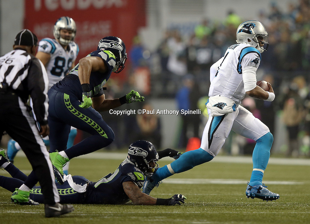 Carolina Panthers quarterback Cam Newton (1) is forced to run as he scrambles away from Seattle Seahawks outside linebacker Bruce Irvin (51) on a second quarter play during the NFL week 19 NFC Divisional Playoff football game against the Seattle Seahawks on Saturday, Jan. 10, 2015 in Seattle. The Seahawks won the game 31-17. ©Paul Anthony Spinelli