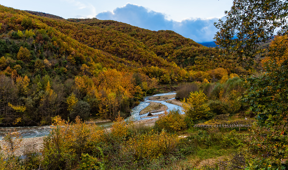 River flowing thru autumn landscape
