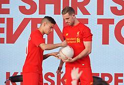 LIVERPOOL, ENGLAND - Monday, May 9, 2016: Liverpool's Philippe Coutinho Correia and captain Jordan Henderson sign a ball at the launch of the New Balance 2016/17 Liverpool FC kit at a live event in front of supporters at the Royal Liver Building on Liverpool's historic World Heritage waterfront. (Pic by David Rawcliffe/Propaganda)