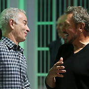 February 28, 2014, Palm Springs, California: <br /> Tournament owner Larry Ellison (right) chats with John McEnroe during the McEnroe Challenge for Charity VIP Draw Ceremony in the newly constructed Stadium 2 at the Indian Wells Tennis Garden. <br /> (Photo by Billie Weiss/BNP Paribas Open)