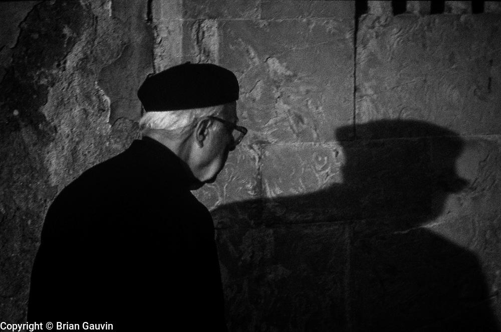Flroence, Italy: Shadow priest at Piazza della Signoria (Signoria square), in front of the Palazzo Vecchio.