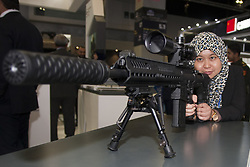 April 17, 2018 - Kuala Lumpur, Malaysia - One of a visitor seen holding a rifle at DSA 2018...The 16th Defense Service Asia Exhibition and Conference also known as DSA 2018. 1,500 companies from 60 nations and more than 50,000 trade visitors from around the world participated in the exhibition. Defense Service Asia has successfully run for almost 3 decades since 1988. (Credit Image: © Faris Hadziq/SOPA Images via ZUMA Wire)