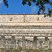 Northern Colonnade at Chichen Itza, Mexico<br /> The Northern Colonnade is the most beautiful part of the Thousand Columns Plaza. The well-preserved round and square columns topped with square capitals stretch for almost 600 feet. Inside was an altar fronted by a long bench. The wall runs parallel to the Temple of the Warriors. A keen eye will spot what seem to be elephant trunks at the edges. These sculptures represent Chaak, the Mayan god of rain and lightning.