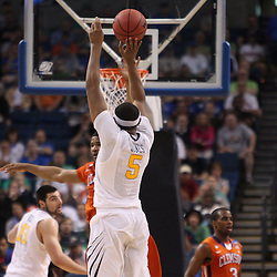 Mar 17, 2011; Tampa, FL, USA; West Virginia Mountaineers forward Kevin Jones (5) shoots against the Clemson Tigers at the end of the first half of the second round of the 2011 NCAA men's basketball tournament at the St. Pete Times Forum.  Mandatory Credit: Derick E. Hingle