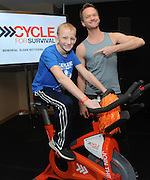 Neil Patrick Harris celebrates the 10th year of Cycle for Survival rides with 14-year-old rare cancer survivor Luke Weber at a 2016 Cycle for Survival event at Equinox Bryant Park in New York, Sunday, March 13, 2016. Cycle for Survival is the national movement to beat rare cancers. 100 percent of funds raised go directly to rare cancer research led by Memorial Sloan Kettering. More than $100 million has been raised since the first ride ten years ago, thanks to support from founding partner Equinox. For more information, visit www.cycleforsurvival.org. (Diane Bondareff/AP Images for Cycle for Survival)