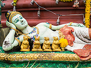 "29 SEPTEMBER 2012 - NAKORN NAYOK, THAILAND: A statue of Shiva, Ganesh' mother, at Wat Utthayan Ganesh, a temple dedicated to Ganesh in Nakorn Nayok, about three hours from Bangkok. Many Thai Buddhists incorporate Hindu elements, including worship of Ganesh into their spiritual life. Ganesha Chaturthi also known as Vinayaka Chaturthi, is the Hindu festival celebrated on the day of the re-birth of Lord Ganesha, the son of Shiva and Parvati. The festival, also known as Ganeshotsav (""festival of Ganesha"") is observed in the Hindu calendar month of Bhaadrapada, starting on the the fourth day of the waxing moon. The festival lasts for 10 days, ending on the fourteenth day of the waxing moon. Outside India, it is celebrated widely in Nepal and by Hindus in the United States, Canada, Mauritius, Singapore, Thailand, Cambodia, Burma , Fiji and Trinidad & Tobago.     PHOTO BY JACK KURTZ"
